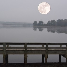 i added the Super moon to my photo of Sibley lake with a wooden pierre in Natchitoches, LA