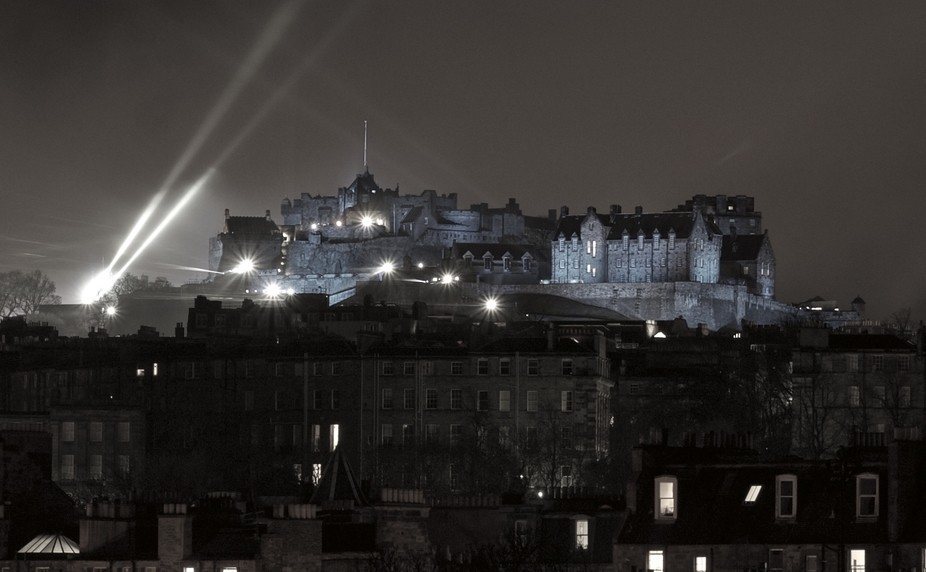 After the new years fireworks show a haze in the air and lights on the castle in Edinburgh