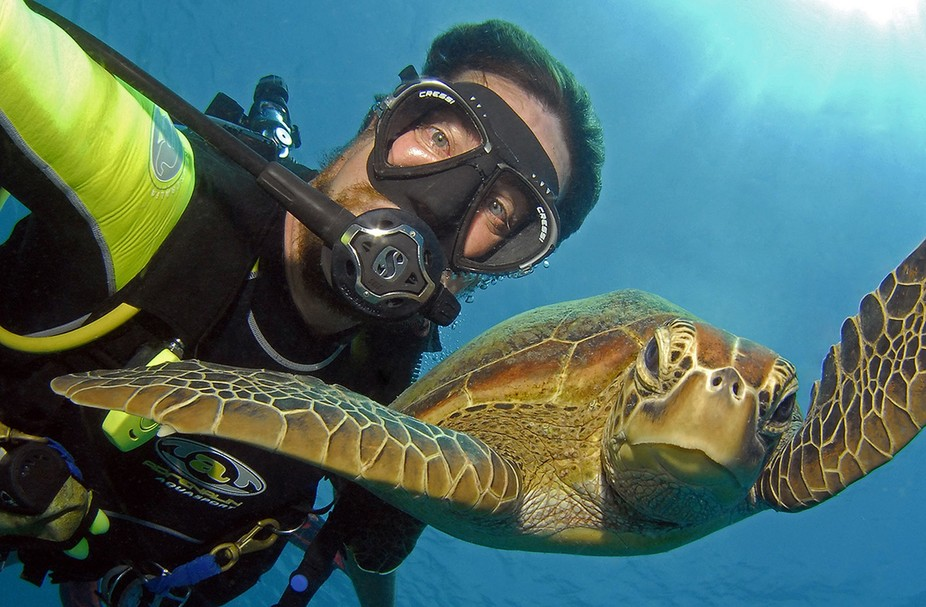 My favorite selfie, taken on the Great Barrier Reef in Cairns at a site called Turtle Bay. The tu...