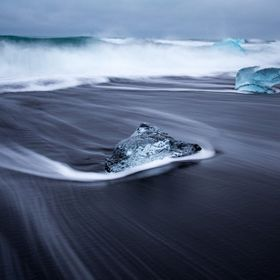 The ice from Jokulsarlon bay wash up on the black sand beaches as gorgeous polished pieces.
