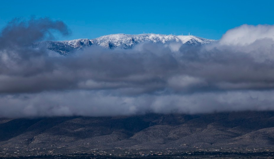 Shot on the first day of 2017 in Tucson Arizona, the mountains got a good dusting of snow while the desert below was soaked. A mere window in time allowed the view on this day just before the next storm rolled in.