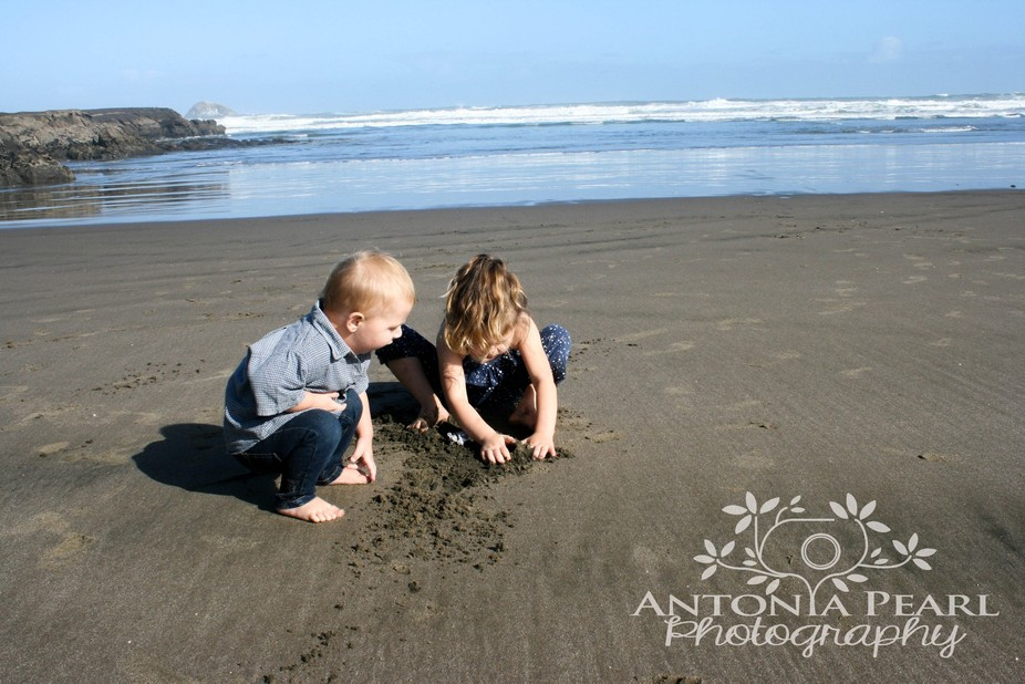 Captured this lovely moment of my children exploring the sand at Muriwai Beach, NZ
