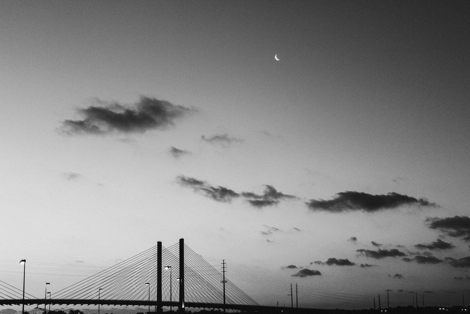 The moon shines over the Indian River Inlet Bridge.