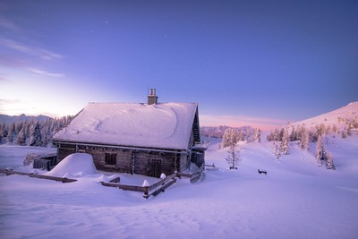 Lonely cabin in a winter sunrise