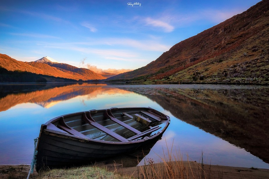 Fishing boat on a lake in the Black Valley, Killarney National Park, County Kerry, Ireland.