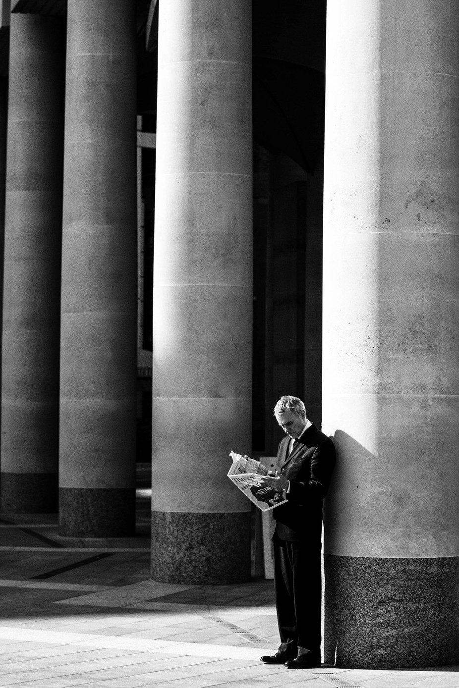 Reading Newspaper by danielwuttke - People In The City Photo Contest