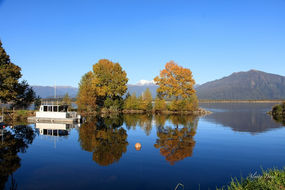 Autumn reflections in Lake Brunner at Moana, NZ.