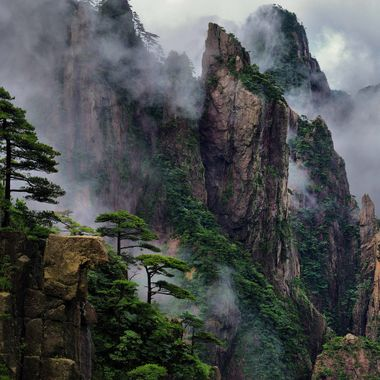 The Huangshan Mountains in China are famous for their steep granite peaks and cloud formations. Clouds can swirl around the mountains, making peaks appear and disappear before your eyes.