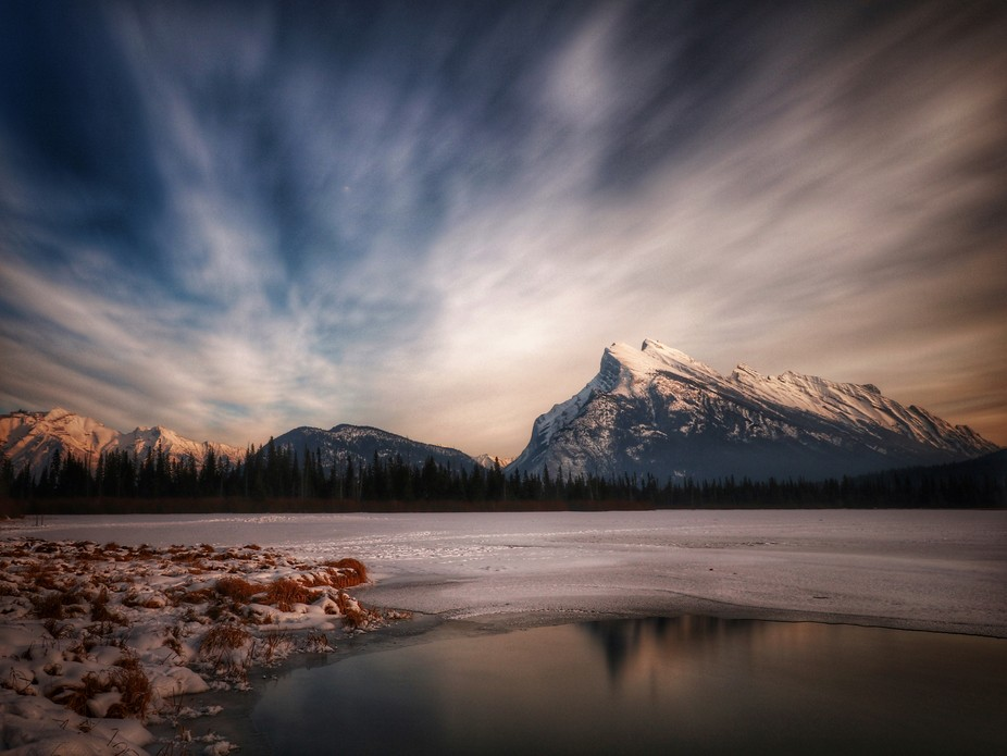 Mount Rundle in Banff National Park with a partly frozen Vermillion Lake