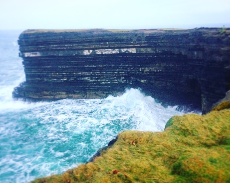 A road trip to North Mayo on a stormy day. Waves crashing onto the exposed cliffs.