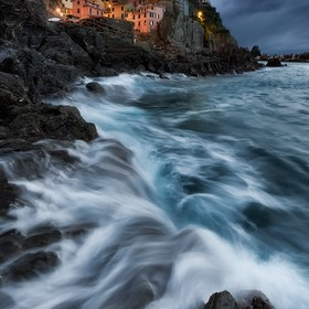 A stormy twilight in the beautiful town of Manarola, in the Five Lands national park (Italy).  This image is a blending of different exposures fo...