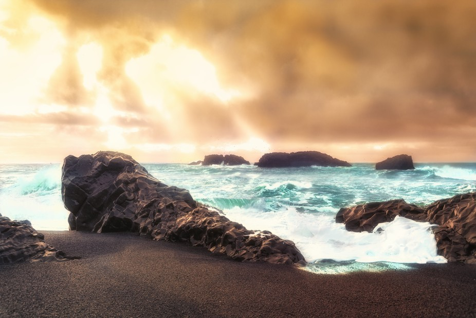 Taken on the Black beach in Iceland Nr Hof the sea was amazing the sun trying to break through th...