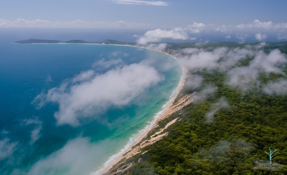 This is the coloured sands at Rainbow Beach Qld looking towards Double Island Point.