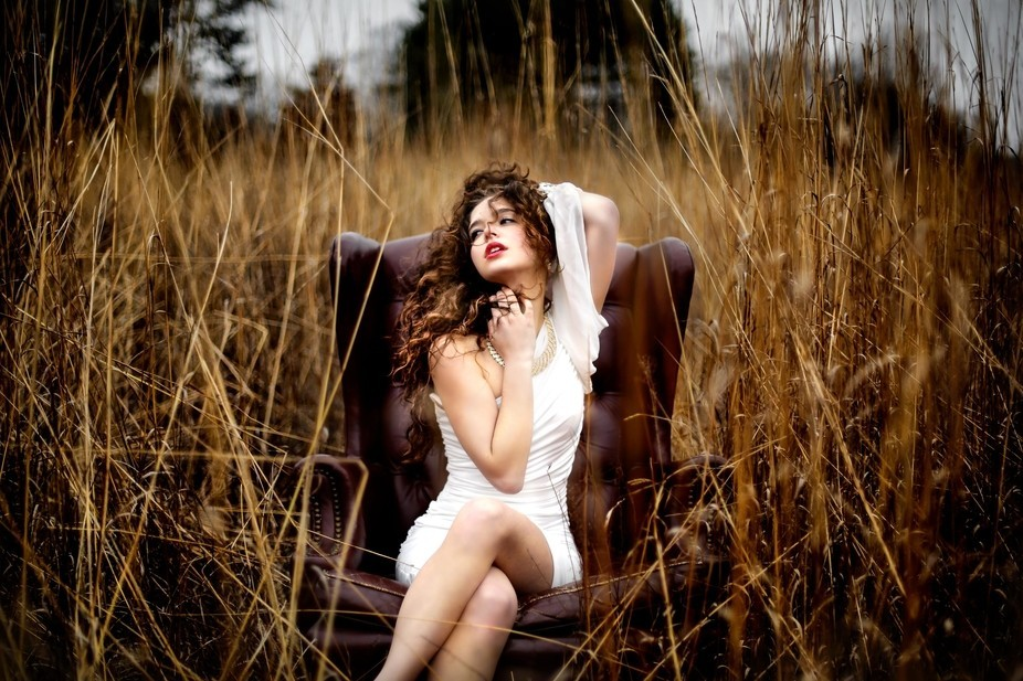 Nikki (model) and I dragged a leather chair about a mile or two out into the arboretum in Ann Arb...