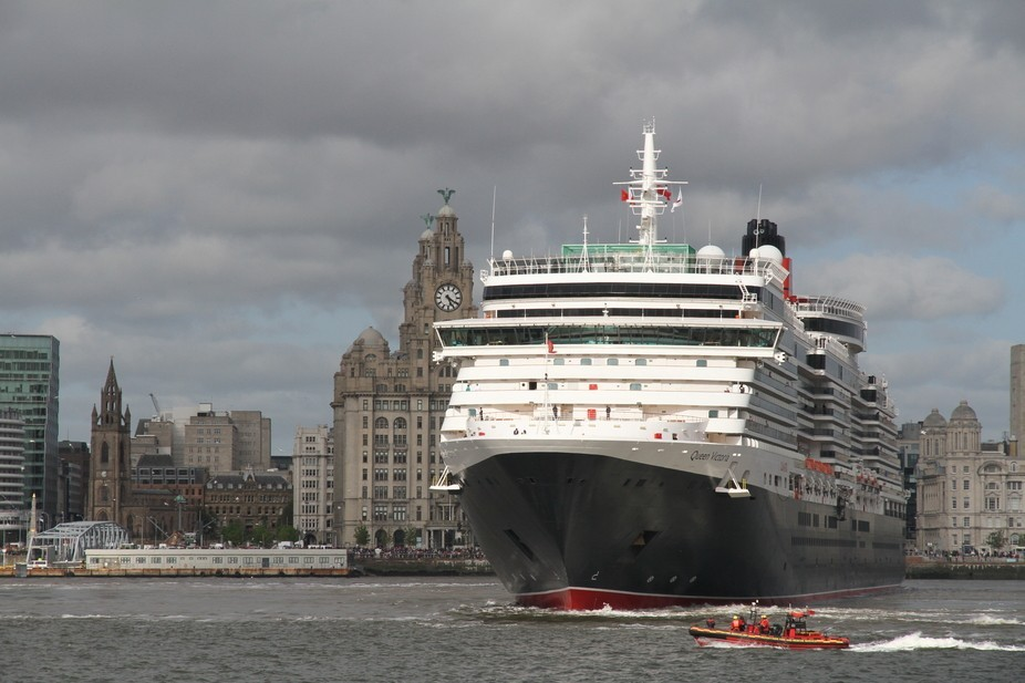 The Queen Victoria seen here leaving Liverpool on 26 May 2015 as she turns to head out of the Riv...