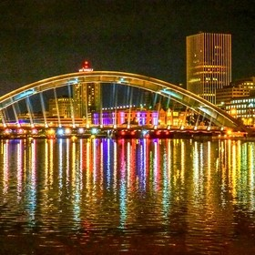 Memorial Bridge Rochester NY night water reflections off genesee river
