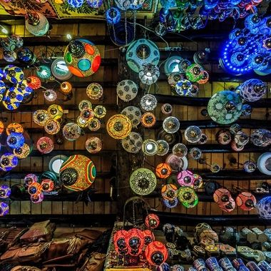 Traditional Moroccan multi-colored hanging lamps in a street craft shop along the busy labyrinthine streets of the Moorish district of the Albaicin in Granada, Spain.