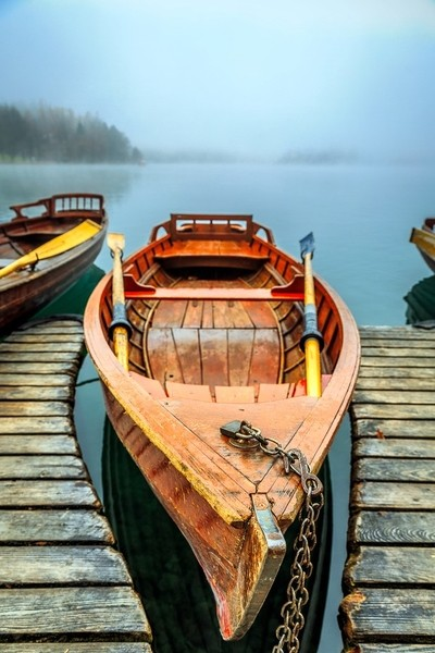 Chained Row Boat on Foggy Lake Bled