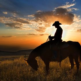 Taken at the Flitner Ranch in Shell, Wyoming as the sun was setting behind this cowboy and his horse.
