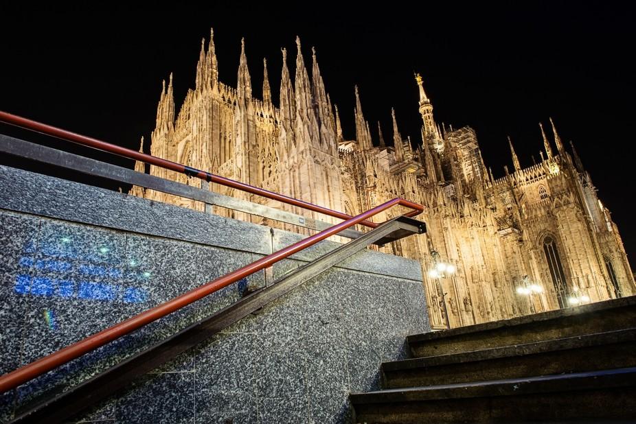 Subway steps arrive at the Duomo. Milan, Italy.