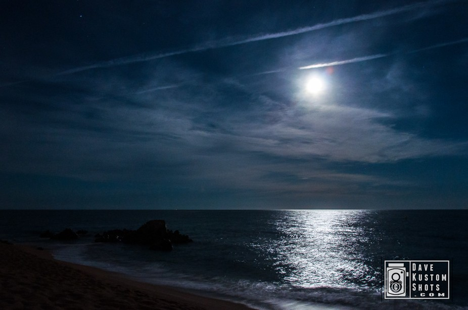 Picture about the full moon rising over mediterranean sea on Sant Pol de Mar, Barcelona (Spain) F...