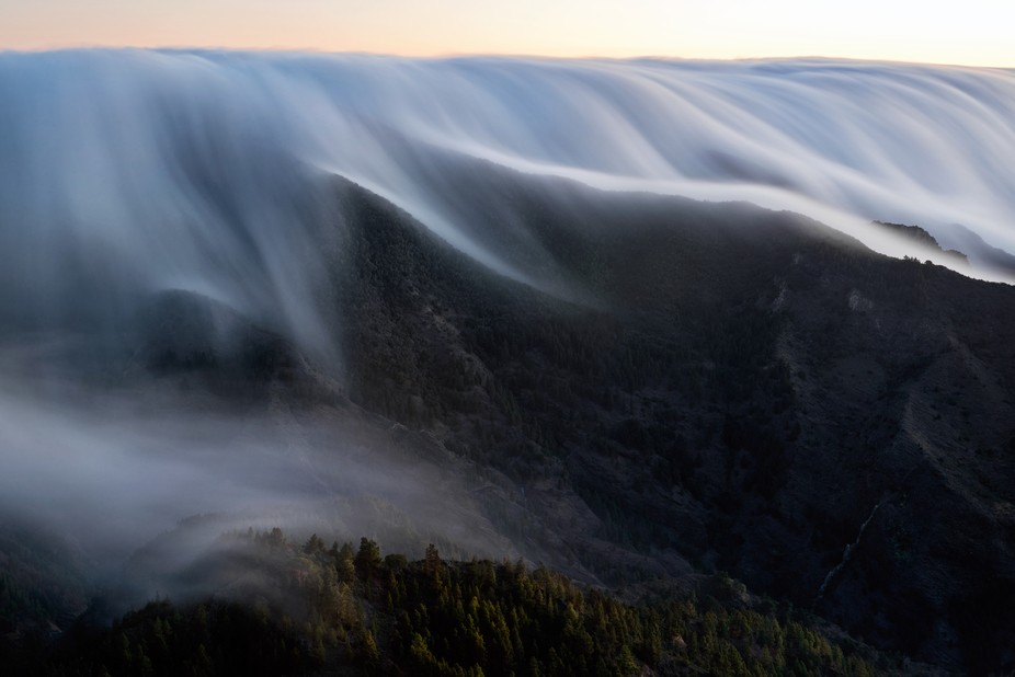 Waking up early to climb up the peaks of La Gomera makes you able to see the clouds crawl over th...