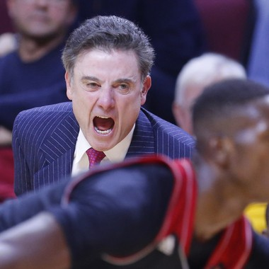 Louisville Cardinals head coach Rick Pitino gives some instruction to guard Terry Rozier (0) during the second half against the Rutgers Scarlet Knights at the Louis Brown Athletic Center.