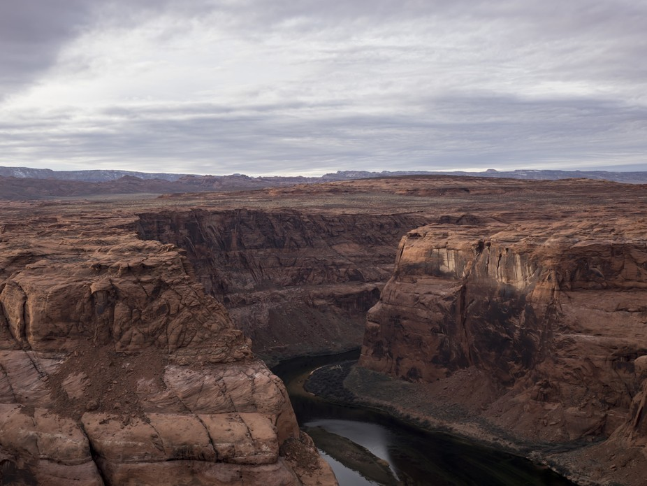 The entrance of the great Colorado River into the Horseshoe Bend of the Grand Canyon. Even on a gloomy winter day, it looks mesmerizing.