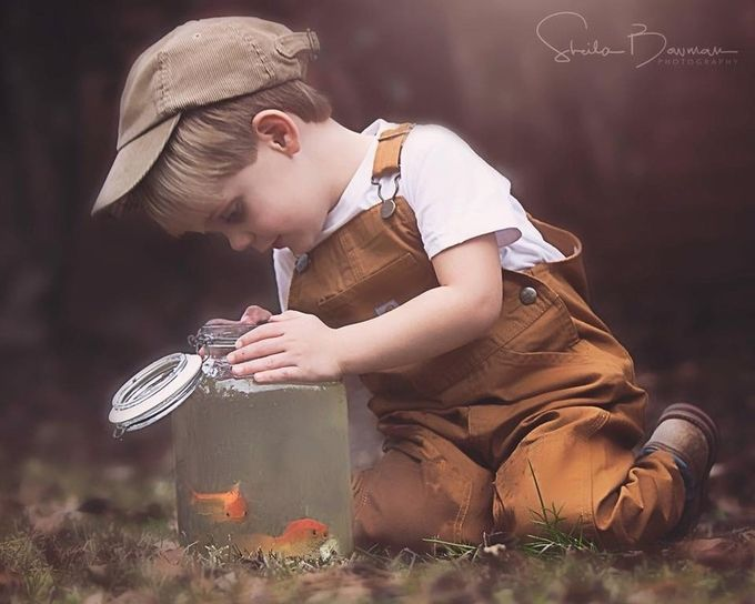 Peeking at his new pet goldfish by Toofargone - Kids And Pets Photo Contest