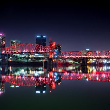 Junction Pedestrian Bridge in Little Rock illuminated in Red