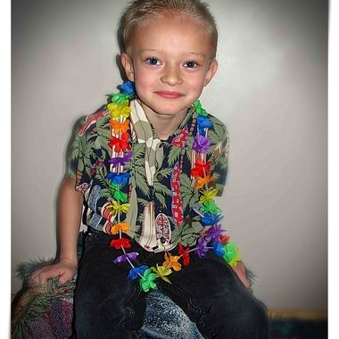 Fighting the winter blues with a Hawaiian photo shoot. This is my 6 year old.