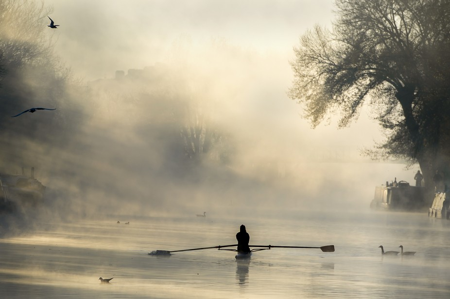 A person rows down the River Lea on the coldest November morning since 2010. Tottenham is not a p...
