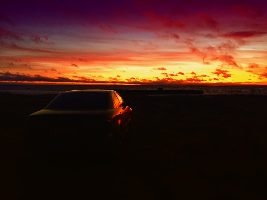 Sunset and silhouette car