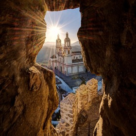 View of a Olvera church from a ruined castle's arrow slit in Olvera, Andalucia, Spain