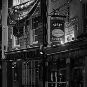 This wouldn't have had half the same impact in colour, being the oldest pubs in Brixham. It was a shame they had a banner across the place, ...