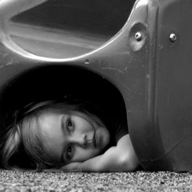 I created this photo of my daughter hiding under a slide at a local park while waiting for a playmate to find her.   Original File name: (2017-1-...