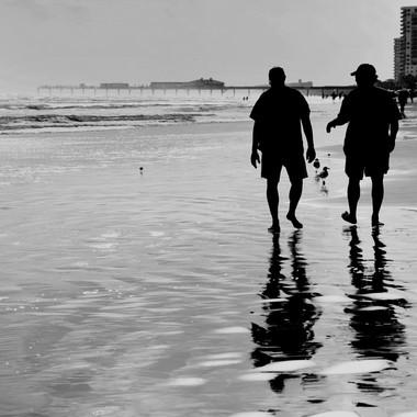 Guys walking the beach