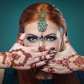portrait of a girl with mehandi on her hands