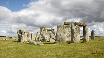 Stonehenge drenched in brilliant summer sunshine - Photo by Robson Smith