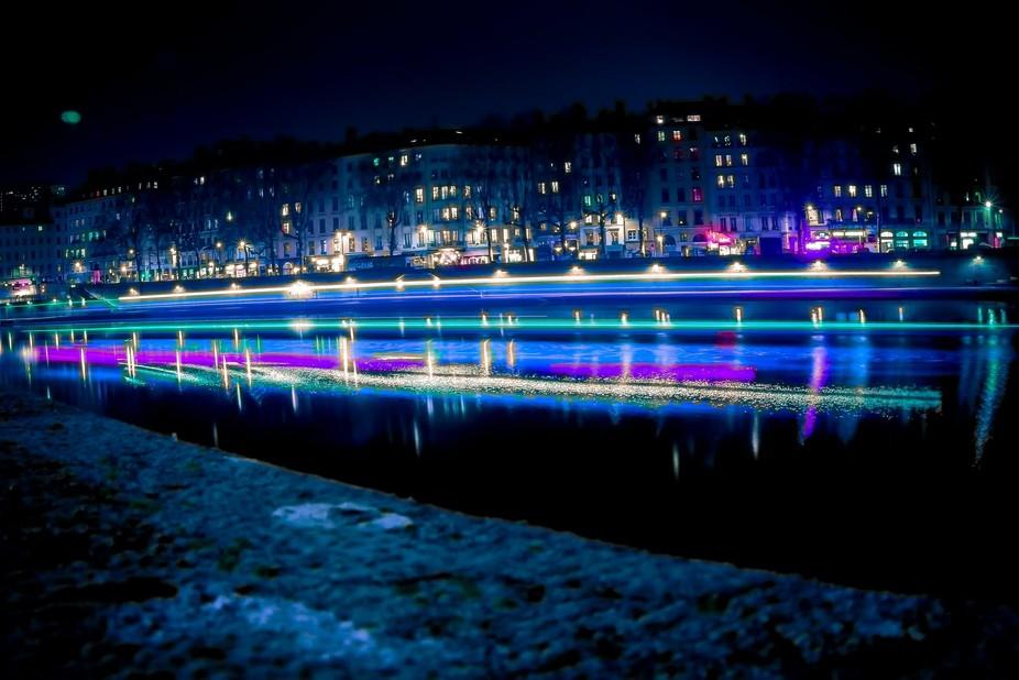 "Shot of a lighting boat above the ""Rhône"" in Lyon"