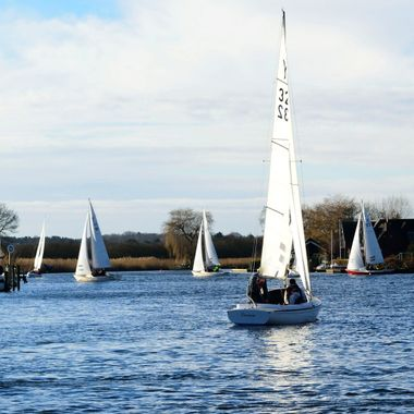 Yachts sailing at Horning on the Norfolk Broads in the UK.