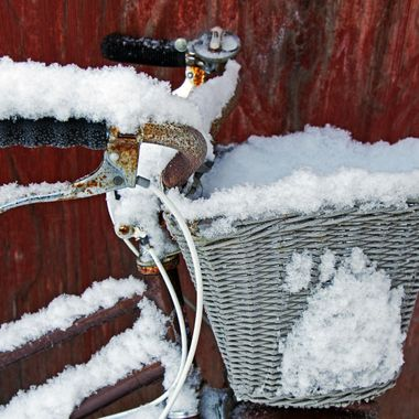 A forgotten bicycle covered in snow.