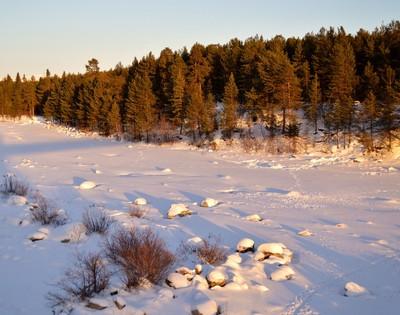Winter.Shore of frozen river