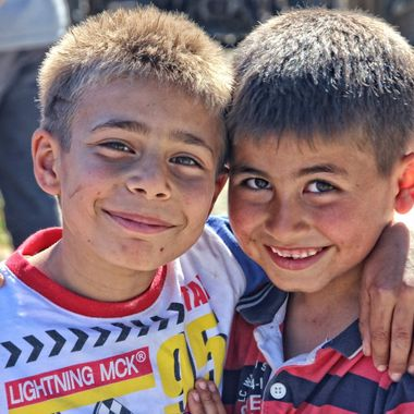 I took this photo when I went to Ağıllar village in Cyprus with my photography students. We were taking photographs of this village when I came accros these children who insisted that I should take a photograph of them, that I did.