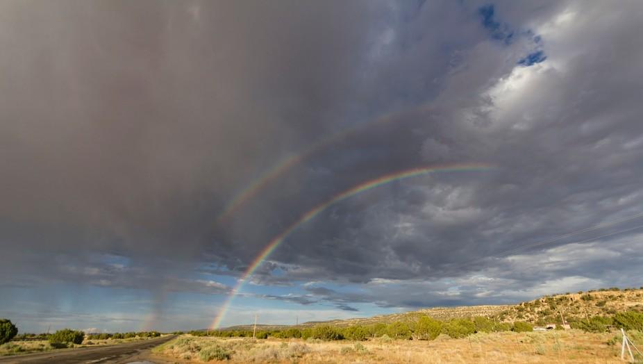 The rain mist generates a double rainbow