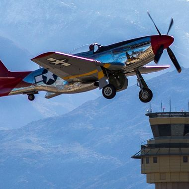 Palm Springs Air Museum P-51 Mustang taking off from the Palm Springs airport for a museum flight demonstration.