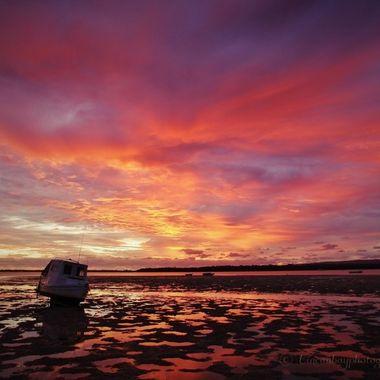 Sunrise over tidal flats