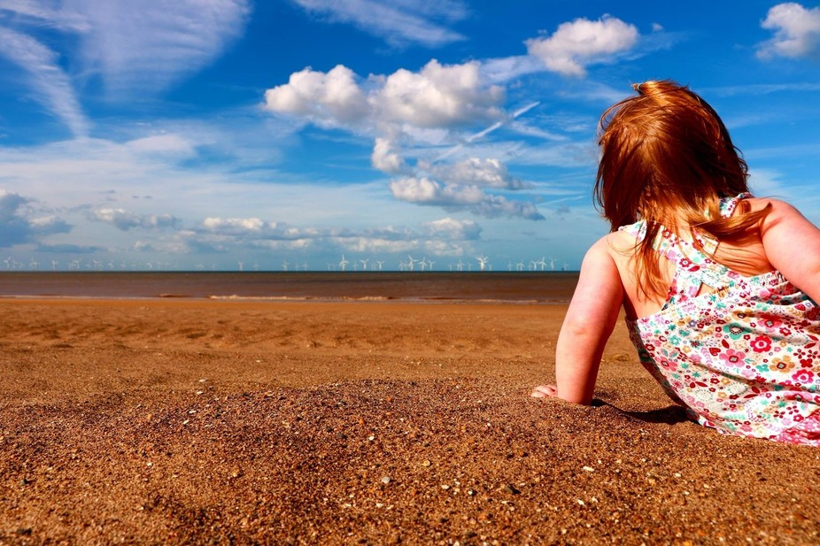 My daughter having a nice look at the sea on the beach in Skegness