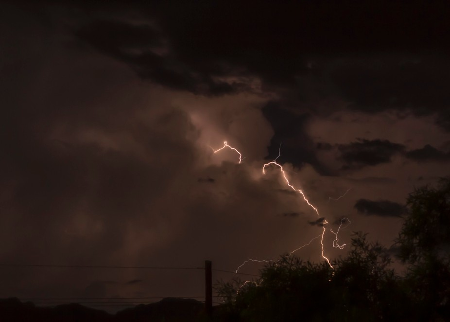 Lightning jumps from cloud to cloud then finally to the ground