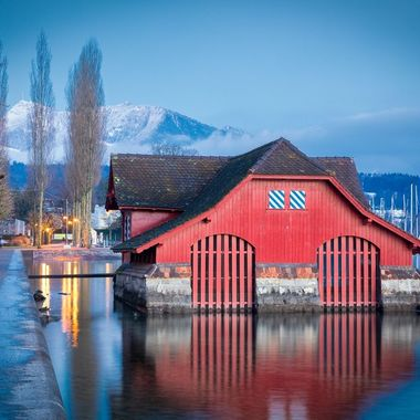 Beauty surrounds Lake Lucerne.  This red boat house is just fantastic.